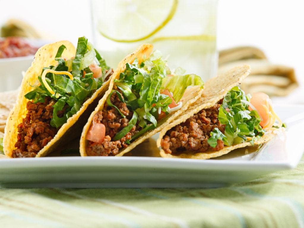 a platter of three tacos shot close up